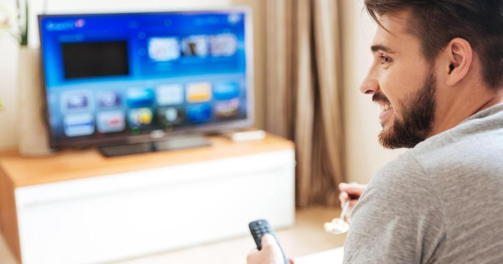 A man watching TV at home (Photo: Shutterstock)