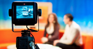 Close-up of a video camera filming a TV show. (Photo: Shutterstock)
